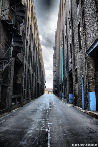 Dark brick warehouse alleyway