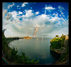 Verto Rainbow (gabrielescotto) Tags: sea sky italy seascape art beach photoshop landscape rainbow bravo italia nuvole mare fisheye cielo stunning napoli naples nikkor vesuvio arcobaleno procida coulds f28 spiaggia chiaia nikond80 gabrielescotto vertorama vertoramas