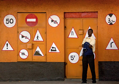 I don't know why, but i think it's a driving school - Kenya (Eric Lafforgue) Tags: africa orange signs man kenya culture tribal tribes afrika drivingschool tradition tribe ethnic tribo homme panneaux afrique ethnology tribu eastafrica autoecole qunia 8347 lafforgue ethnie colorphotoaward  qunia    kea    a