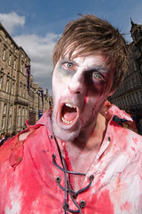 Zombie (Surely Not) Tags: edinburgh fringe festival 09 street portrait openingnightofthelivingdead zombie wide angle scotland nikon d300 sb800 yourphototips moo