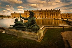 The Golden Treasure of the King (Gilderic Photography) Tags: summer sky panorama sculpture cloud sun paris france reflection castle history water grass statue architecture garden gold soleil eau europe king jardin sunny panasonic reflet ciel versailles histoire palais chateau nuage herbe bassin roi louisxiv lumic lx3 platinumheartaward dmclx3
