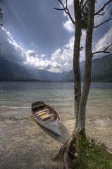 Boat at lake Bohinj (#1) (Bas Lammers) Tags: light sun lake water canon boat ray slovenia hdr bohinj photomatix 50d platinumheartaward