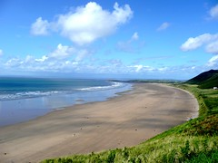 Rhossili Beach (Tasmin_Bahia) Tags: blue sea summer sky people plants brown sun white plant black colour detail green nature water beautiful grass clouds outside outdoors sand weeds pretty waves peace shadows bright peaceful sunny hills ripples colourful simple whispy rhossilibeach tasminbahia