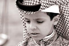 Saudi Boy [ colorless ] (Abdullah.N.KH) Tags: ocean sunset sea portrait abstract building nature colors smile silhouette sunrise canon landscape sadness waves 300d desert natural happiness wideangle nassir abdullah oldhomes  khamees 5dmark2 mark|| abdullahnasser