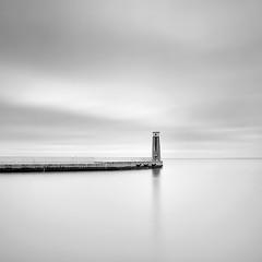 The Lone Sentry (mkownacki) Tags: longexposure sea lighthouse olympus baltic minimal breakwater gdynia e620