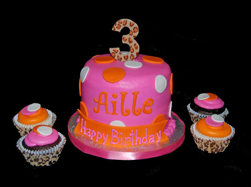 pink and orange cheetah 3rd birthday cupcake tower for a Diego celebration