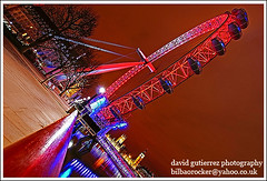 London eye at Night ~ My London Red Eye...~ (davidgutierrez.co.uk) Tags: road city uk greatbritain travel bridge red england sky urban color reflection green london eye tourism colors westminster fashion wheel thames modern night reflections river pier education media europe diverse unitedkingdom britain sony south politics capital great culture cityscapes bank londoneye millenium landmark icon entertainment hungerford historical alpha multicultural riverthames metropolitan touristattraction dt attraction countyhall cityoflondon squaremile cityofwestminster redcolor f4556 supershot 1118mm mywinners anawesomeshot worldicon londonred londoncolors londoncolour muncipality londoncolor londoncolours sonyalphadt1118mmf4556 sonyα350dslra350