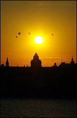 Sunset over the city churches. (spikefot) Tags: city sunset shadow sun sol church water pentax stockholm stan gamlastan oldtown vatten solnedgång skugga kyrkor luftballonger rubyphotographer