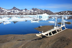 Tasiilaq Greenland (christine zenino) Tags: reflections europe arctic greenland glaciers inuit sleds 1000views sleddogs grnland dogsled grnland groenland groenlandia 5photosaday 1000plusviews tasilaq angmassalik tasiilaq grnland ammasalik  tasiilaqgreenlandtravelguide greenlandtravelguide villageoftasiilaq greenlandichuskypuppy inuitvillage
