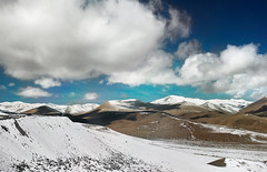 Polar Pillow Sky (Jeremy Snell) Tags: china blue sky snow mountains cold west clouds skies pass pillows dirt xinjiang 24mm polar
