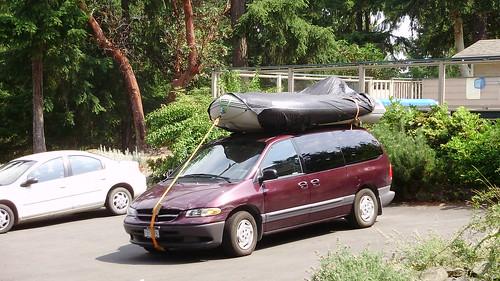 purple van with boat