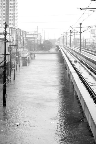 Shot from V. Mapa station, street flooded at depths between 4-5 ft., by rembcc (n.b.: yes, that is a man trying to keep afloat)