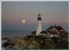 Portland Head Lighthouse (mariaaobrien) Tags: ocean york sky moon lighthouse beach water portland elizabeth cloudy dusk head maine newhampshire cape breakwater neddick nubble whaleback springpoint