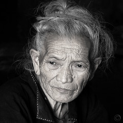 Generations -- Hmong Great Grandmother (NaPix -- (Time out)) Tags: portrait bw woman black 6x6 senior face canon square asia grandmother spirit vietnam explore soul elder goldenage generations emotions sapa hmong tms 500x500 tellmeastory arriregrandmre explored explorefrontpage sunsetoflife napix winner500 500x500portrait7