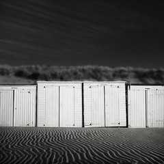 -[_][_]- (Joel Tjintjelaar) Tags: square ripples beachhouse domburg tjintjelaar strandkabientjesiloveflemish ireallywasntgoingtoblowupallthebeachhouses thepeopleonthebeachwereallwatchingme haventtheyeverseenamaninblackleatherjacketanddarksunglassescarryingatripodthatlookedabitlikearocketlauncher gaussianbluronthegrass