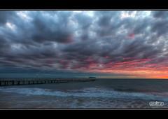 Dramatic Sunset at Henley - HDR (Dale Allman) Tags: ocean sunset sky seascape beach nature water clouds canon lights pier sand surf australia adelaide southaustralia lightpole hdr highdynamicrange 1740 henleybeach 3xp photomatix henleyjetty 5dmkii