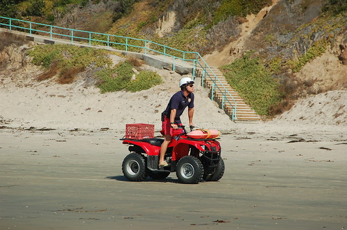 A San Diego lifeguard riding an ATV.