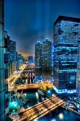 Chicago River [Explored] (big_pixel_pusher) Tags: blue urban chicago reflection cars window water yellow night buildings river boats lights hotel view crane ships bridges chicagoriver hdr spotlights clubquarters bppfoto