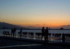 Just one more..flickr is soothing:) (Tulay Emekli) Tags: sunset reflections couple silhouettes cropped seafront stroll breakwall izmir pasaport romanticcouple