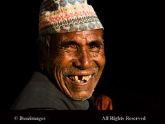 NEPAL (BoazImages) Tags: life travel nepal portrait smile face hat portraits fun faces joy smiles documentary tradition himalaya hindu boazimages lpfaces