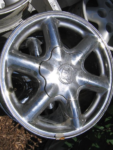This is an aluminum wheel with a chrome finish. Aluminum wheels can have several kinds of finishes including polished, two toned and chrome.