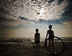 My childhood.... (Shad0w_0f_Dark) Tags: sea sun water wheel ray child play d200 1020 bangladesh kuakata flickraward5
