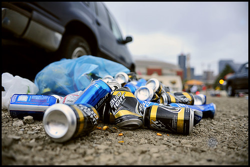 Cans of Bud Light spill out of a recycling bag in a parking lot near Edward Jones Dome after the MU-Illinois game. The cans with team colors have attracted controversy after university officials claimed that the cans encourage drinking among sports fans.