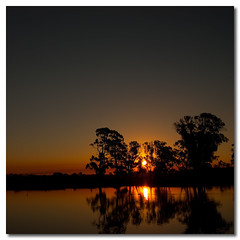 My Livingroom View (Sam Ilić) Tags: light sunset sky sun color reflection water silhouette canon pond soft australia symmetry canberra 450d canberrasunset canon24105mm4