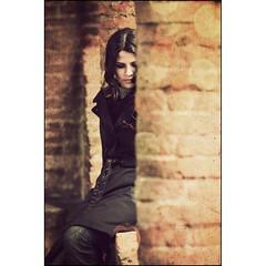 Simona of the Columns (manlio_k) Tags: texture girl canon vintage dof gimignano columns wife sangimignano simona