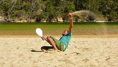 The catch! ( Talles Vito) Tags: trees playing man green beach water canon ball australia raquete 40d worldbest flickrestrellas frecoball