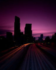 Twilight (Jeff Engelhardt) Tags: seattle city sunset building tower night skyscraper canon evening twilight downtown cityscape nocturnal metro headlights taillights lightstreams lightstreaks ridonkulous 40d jeffengel jeffengelhardt