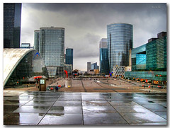 La defense 2 (in eva vae) Tags: city light paris rain clouds nuvole place skyscrapers piazza colori pioggia hdr defence luce citt parigi blueribbonwinner grattaceli flickrestrellas sailsevenseas