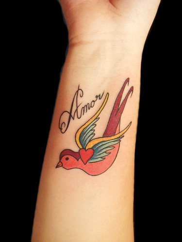 amore tattoo designs. Swallow and amor custom design