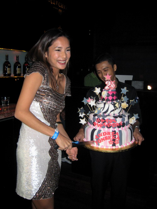 Andrea cutting her birthday cake A Malaysia International Fashion Week