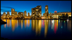 Reflected on False Creek (Eric Flexyourhead) Tags: ocean blue canada reflection tower water yellow skyline night vancouver buildings gold lights downtown bc apartment britishcolumbia vibrant vivid explore yaletown falsecreek bluehour colourful 169 frontpage highrises bcplace zd 1260mm perfectescapes olympuse3