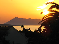 San Stephanos, Corfu 2008 (Holfo) Tags: sunset cloud sun seascape beautiful yellow canon mediterranean powershot greece greekislands corfu shard stefanos ionian sanstephanos ionianislands aghiosstefanos