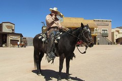 Cowboy Cal on a Cayuse (BarryFackler) Tags: vacation arizona horse southwest west movie cowboy gun desert boots dry rope mount lariat bandana steed cowboyhat movieset wildwest chaps arid saddle harmonica holster lasso nag oldwest stuntman americansouthwest oldtucson reins sixshooter moviestudio 2011 oldtucsonstudios saddleblanket cayuse gunbelt pimacounty cowboycal barryfackler barronfackler