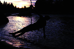 extend arms 'cross the river (bijoubaby) Tags: sunset shadow dog water silhouette river cross arms surface swing twirl figure across ropeswing skim extend netneutrality matters2me
