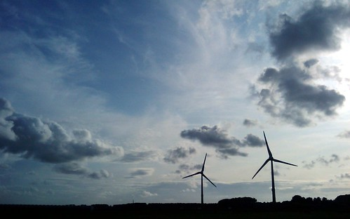 dead mans chest wallpapers. 2 wind turbines across clouded sky