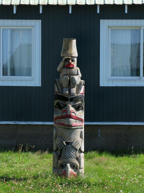 totem in front of Claude Morrison's house, Hydaburg, Alaska