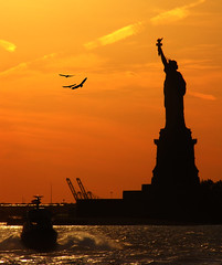 Statue of Liberty during Sunset (ajagendorf25) Tags: park new york city sunset monument water birds statue canon river liberty island coast boat october ellis manhattan guard 11 cranes national jersey hudson shipping immigration governors sx10 platinumheartaward jagendorf