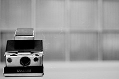 POLAROID SX-70 Land Camera (victoria.anne) Tags: camera old blackandwhite white black classic film polaroid lovelovelove bwhite ilovefilm ilovethiscamera takeninthelobbyofmyschool mymomfounditformeusedatbrandonvaluevillageforaround5dollars