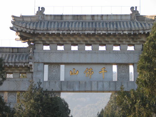 Buddhist temple gate in concrete and gold