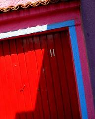garage in shadow (for sguardojos) (msdonnalee) Tags: red abstract rot mexico rouge rojo  reddoor vermelho porta sanmigueldeallende mexique rosso tr mexiko abstrakt garagedoor  abstrait rd  punainen    ifyouseeredshootit colourartaward  photosbydonnacleveland