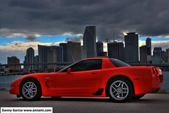 Corvette Z06 in Downtown Miami with storm brewing HDR (dgmiami) Tags: ocean blue red sky urban storm building water skyline clouds skyscraper buildings downtown florida miami corvette hdr z06 corvettez06