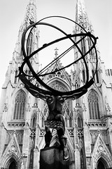Atlas & St. Patrick's Cathedral, Manhattan (welshio) Tags: city nyc newyorkcity urban bw sculpture usa newyork film church monument monochrome architecture circle landscape globe worship cityscape cross cathedral spires manhattan religion stpatrickscathedral modernism 5thavenue grand arches landmark scan lookingup depthoffield midtown sphere views udo atlas torso artdeco neopan rockefellercentre christianity plinth zonesystem urbanlandscape oldnew gothiccathedral leelawrie atlassculpture gothicarches moderngothic blackwhitefilm foregroundbackground pullprocessing americanmonuments