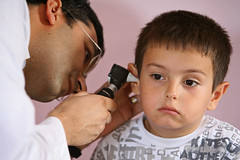 A child receives an ear exam as part of an overall health check up (World Bank Photo Collection) Tags: hospital turkey europe child patient medical health doctor ear medicine clinic exam worldbank physician checkup examination
