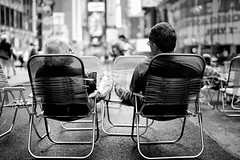 Relax! (Philipp Klinger Photography) Tags: street new york city nyc trip travel camping light shadow people bw usa white holiday ny black feet up america square relax us blackwhite chair nikon shoes tour dof open state chairs theatre bokeh weekend manhattan district candid united von wide relaxing empire times states amerika philipp notraffic staaten klinger vereinigte of d700 sigma50mmf14 dcdead