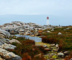 Lighthouse at Peggy's cove, NovaScotia, Canada (GlossyEye.) Tags: world travel lighthouse canada beautiful landscape photography la nikon rocks novascotia 55mm fa differenza  lamicizia nikond40  pegyscove lamiciziafaladifferenza picnikorpicnic