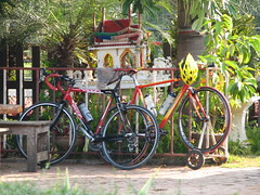 Two Bicycles and Shrine (Crouching Tiger Team) Tags: trip travel vacation people holiday nature bike bicycle thailand happy cycling golden triangle cyclist tour mai chiang rai